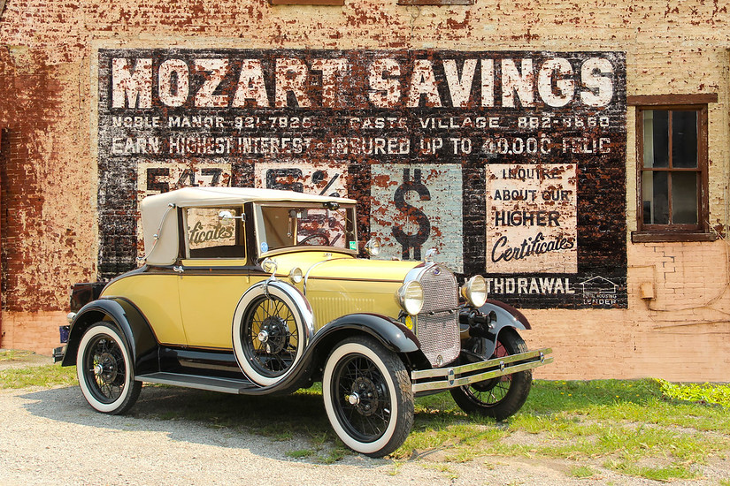 1929 Ford Model A Cabriolet Coupe and Mozart Savings sign, Pittsburgh, PA.
